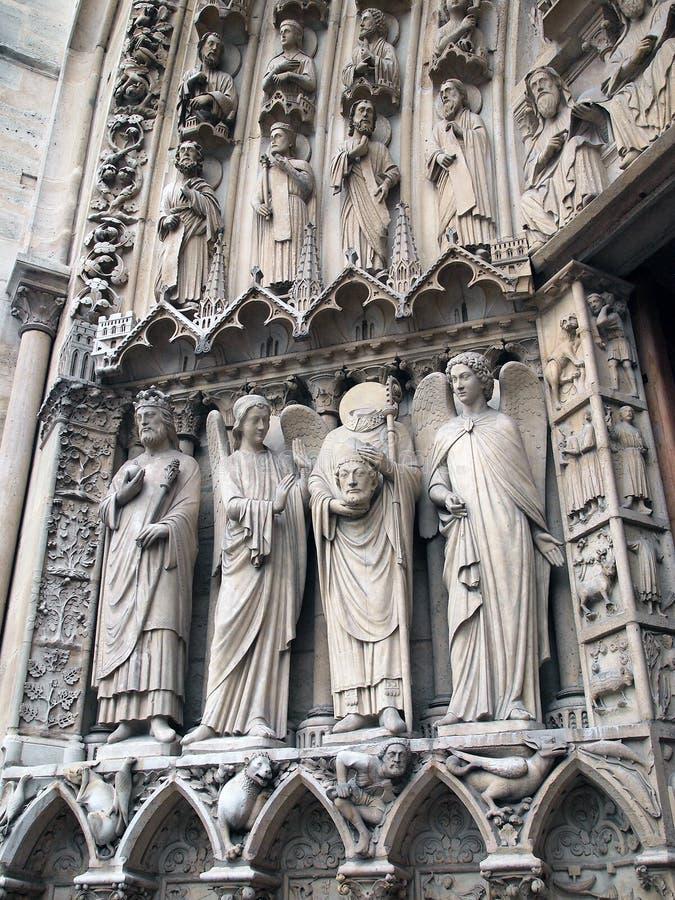 Bas Relief Sculptures, Notre Dame Cathedral, Parigi, Francia fotografie stock libere da diritti