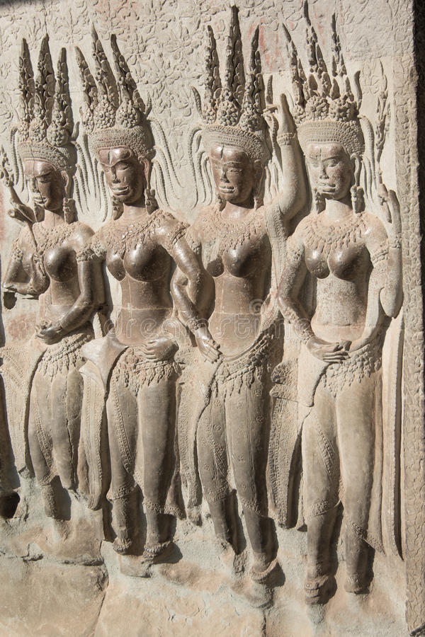 Bas-relief on the walls of the Angkor Watt stock photography