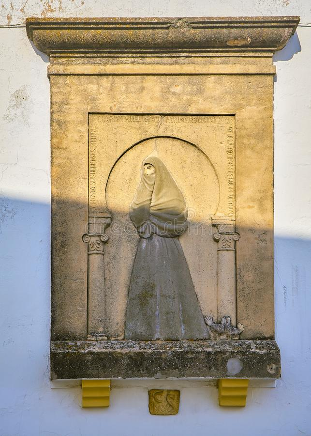 Vejer de la Frontera downtown. Cadiz province, Andalusia, Spain. Bas-relief of the women known as Cobijado on principal facade of the Church of Our Lady of royalty free stock image