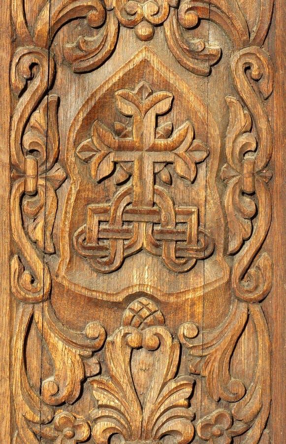 Bas relief in wood carved wooden door background