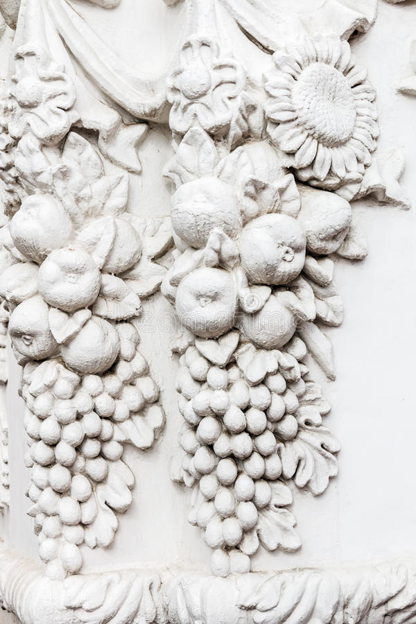Bas-reliefs and sculptural details in the design of stone. Art royalty free stock photo