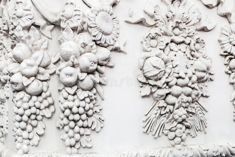 Bas-reliefs and sculptural details. In the design of stone art stock image