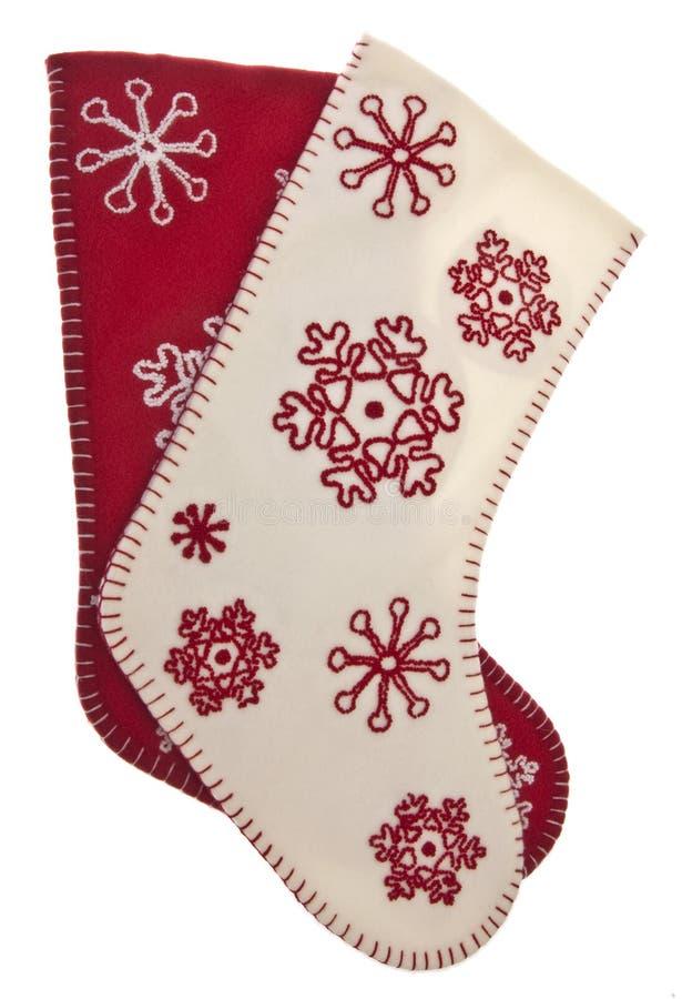 Bas rouges et blancs de vacances de configuration de flocon de neige photo stock