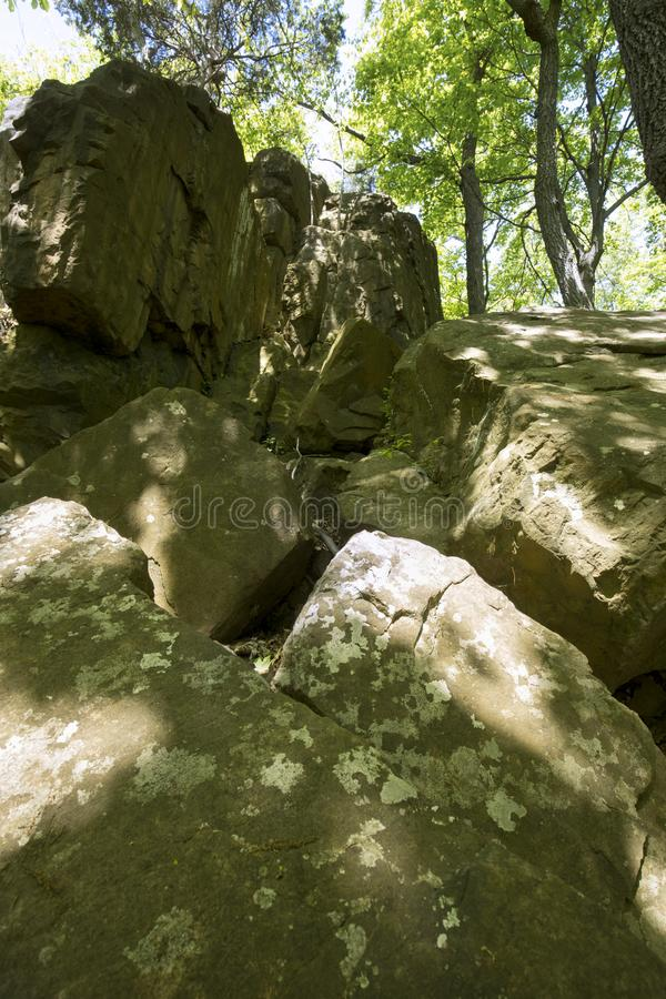 Basalt outcrop from ancient volcanoes in Meriden, Connecticut. Basalt outcrop from ancient volcanoes on Lamentation Mountain in Giuffrida Park, Meriden stock photo