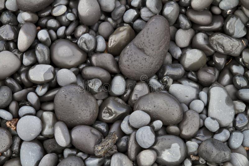 Basalt Pebbles. Close up of basalt pebbles on an Icelandic beach stock photos