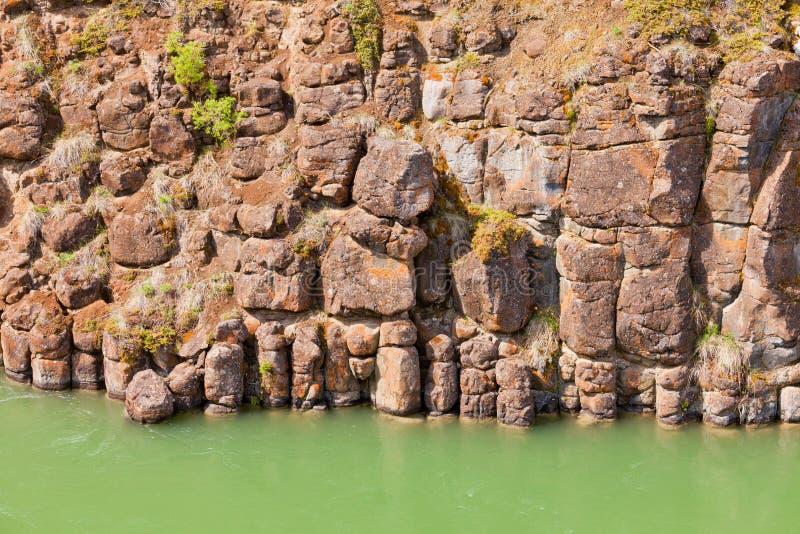 Basalt rock columns of miles canyon yukon canada stock for River rock columns