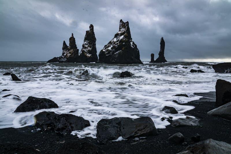 Basalt rocks Troll toes on black beach. at storm Reynisdrangar, Vik, Iceland. Basalt rock formations Troll toes on black beach. at storm Reynisdrangar, Vik royalty free stock photos