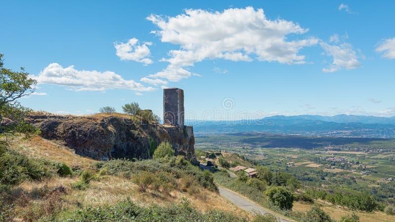 Basalt tower of castle ruin in Mirabel in the Ardeche region of France. Basalt tower of castle ruin in Mirabel, Ardeche mountains, France royalty free stock image