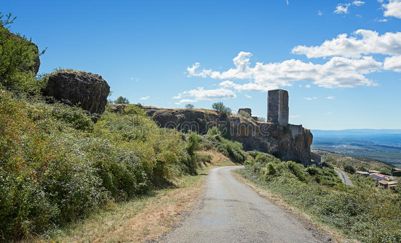 Basalt tower of castle ruin in the picturesque village of Mirabel Ardèche, France. Basalt tower of castle ruin in Mirabel, Ardeche mountains, France royalty free stock photos