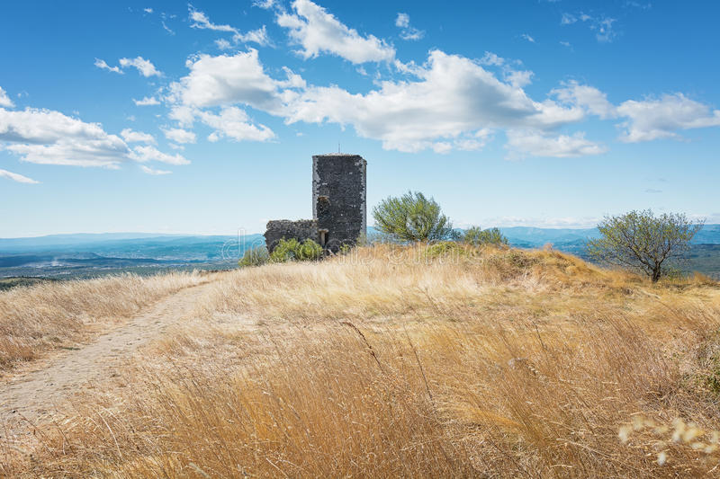 Basalt tower of castle ruin in the picturesque village of Mirabel Ardèche, France. Basalt tower of castle ruin in Mirabel, Ardeche mountains, France stock images