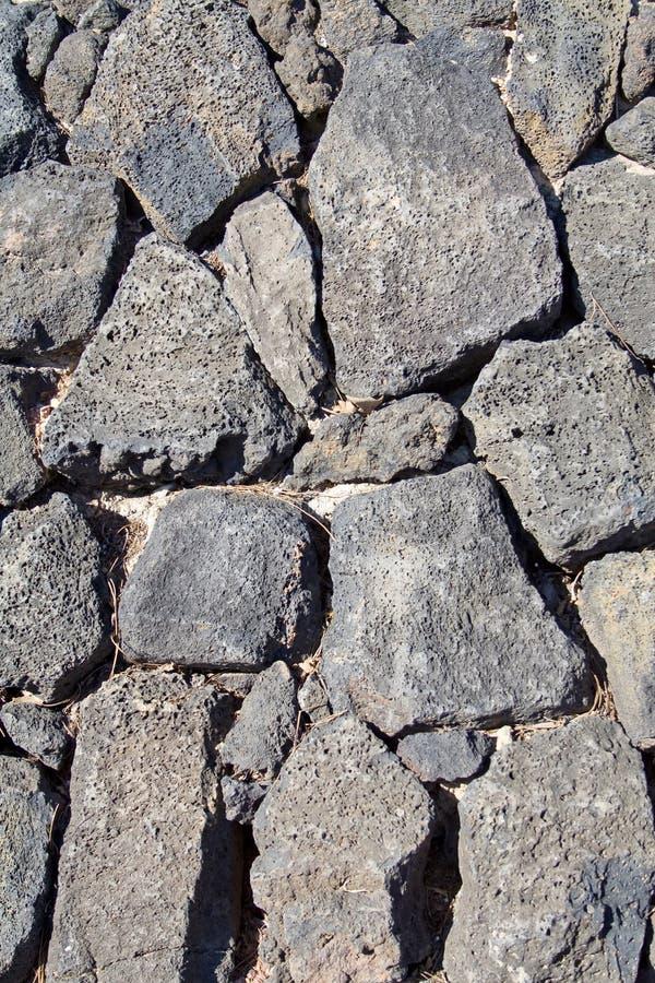 Basalt (volcanic rock) wall made stock photos