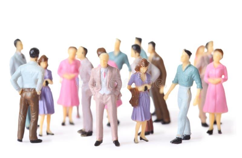 Basamento della gente del giocattolo nelle pose differenti fotografia stock