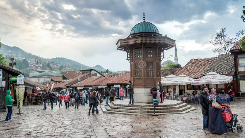 Bascarsija square with Sebilj wooden fountain in Old Town Sarajevo, capital city of royalty free stock photo