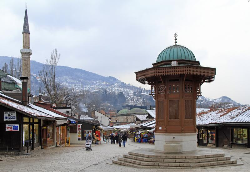 Bascarsija square with Sebilj wooden fountain in Old Town Sarajevo stock images