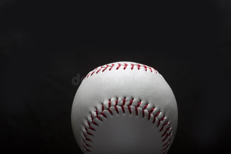 Base-ball d'isolement sur le fond noir photo libre de droits