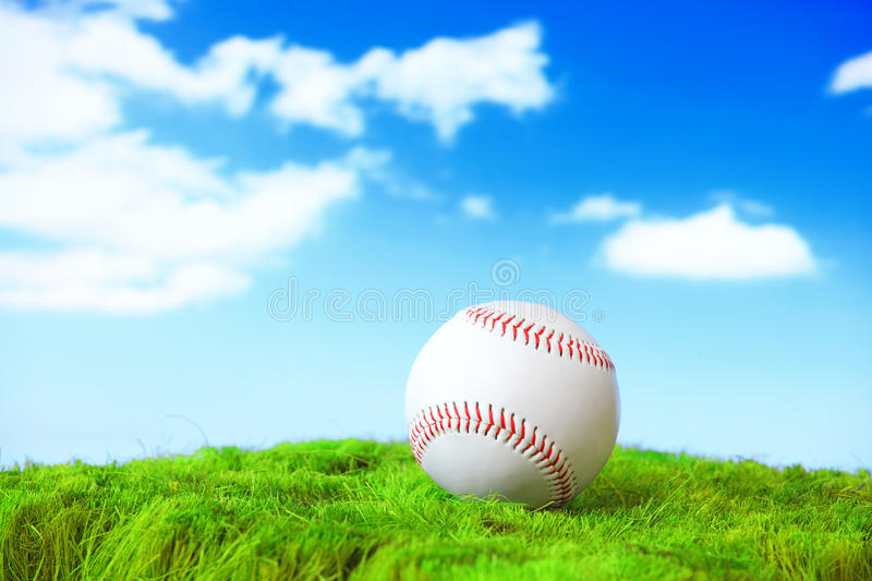 Base ball in green grass field royalty free stock photos