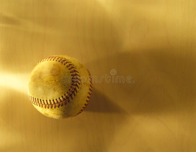 Base-ball sur le bois photo stock