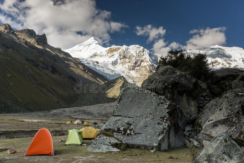 Base camp in the Cordillera Blanca with snow-capped mountains and large boulders royalty free stock photography