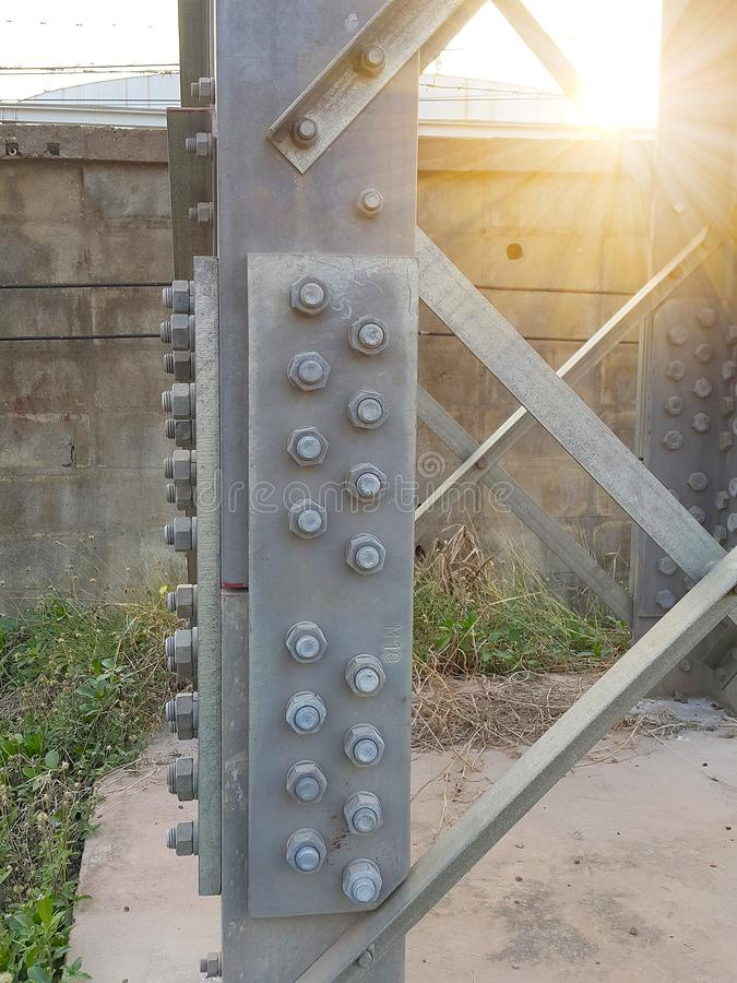 The base construction of the high voltage tower have bolts and nuts royalty free stock photography