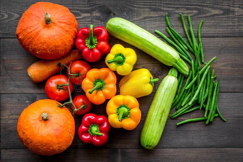 Base of healthy diet. Vegetables pumpkin, paprika, tomatoes, carrot, zucchini on dark wooden background top view royalty free stock photos