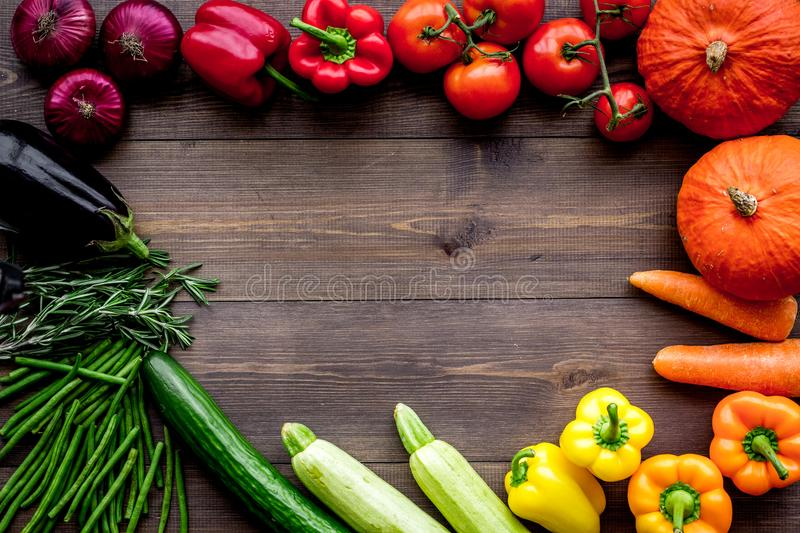 Base of healthy diet. Vegetables pumpkin, paprika, tomatoes, carrot, zucchini, eggplant on dark wooden background top stock images