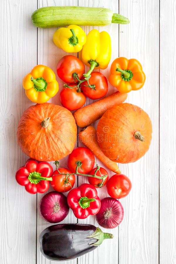 Base of healthy diet. Vegetables pumpkin, paprika, tomatoes, carrot, zucchini, eggplant on white wooden background top royalty free stock image