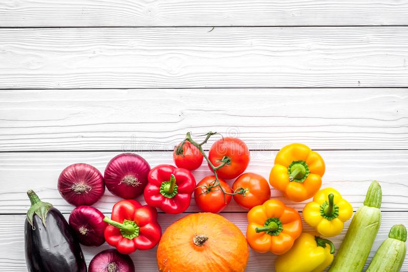 Base of healthy diet. Vegetables pumpkin, paprika, tomatoes, carrot, zucchini, eggplant on white wooden background top royalty free stock images