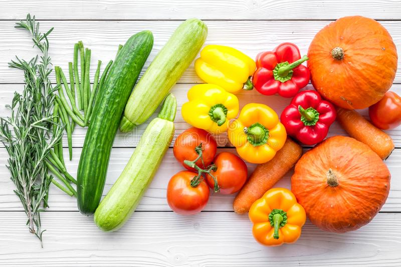 Base of healthy diet. Vegetables pumpkin, paprika, tomatoes, carrot, zucchini on white wooden background top view royalty free stock photography