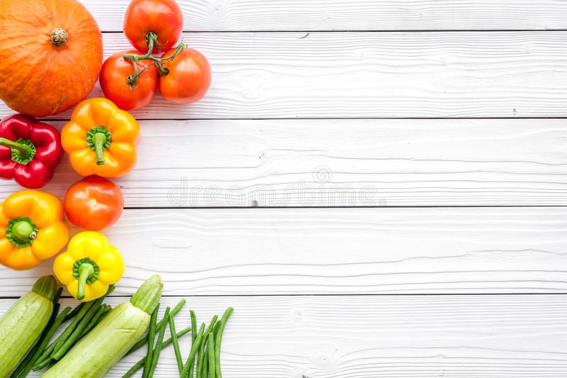 Base of healthy diet. Vegetables pumpkin, paprika, tomatoes, carrot, zucchini on white wooden background top view stock photos
