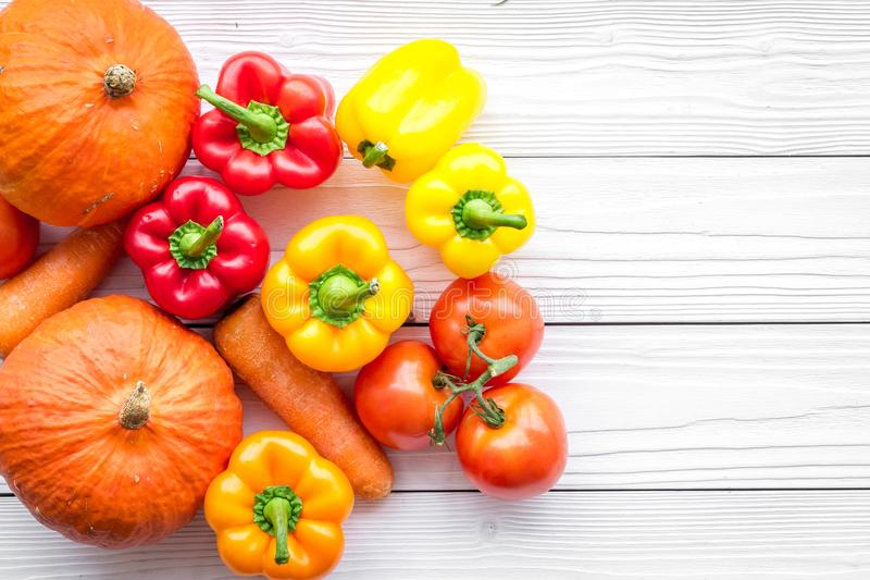 Base of healthy diet. Vegetables pumpkin, paprika, tomatoes, carrot on white wooden background top view copyspace stock photos