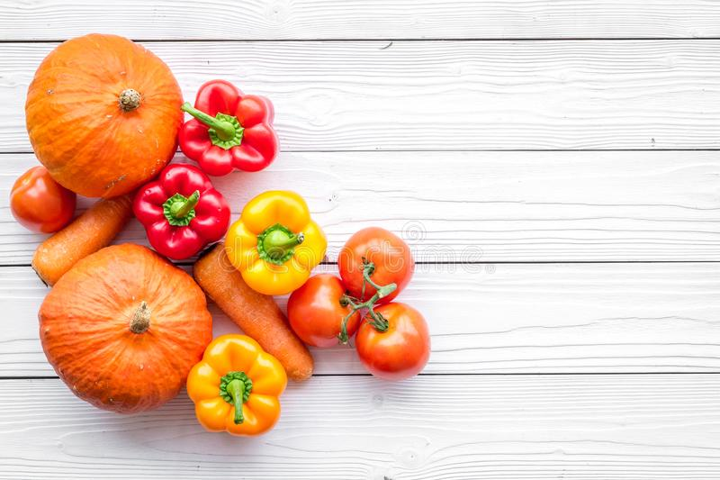Base of healthy diet. Vegetables pumpkin, paprika, tomatoes, carrot on white wooden background top view copyspace stock images