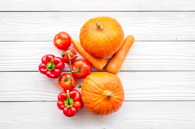 Base of healthy diet. Vegetables pumpkin, paprika, tomatoes, carrot on white wooden background top view copyspace stock photo