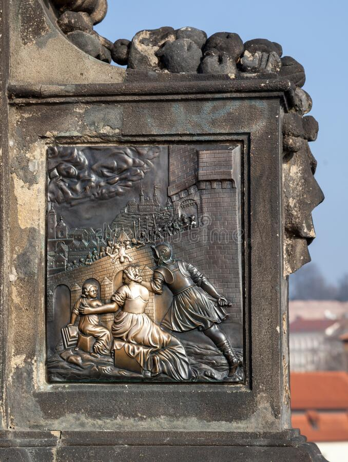 Base of John of Nepomuk statue on the Charles bridge in Prague stock photo