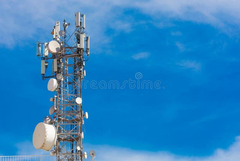 Base station. Mobile phone communication signal, antenna and radio transmitter receiver. iletişim arka plan. İzole mavi arka plan. Metniniz için bo royalty free stock image