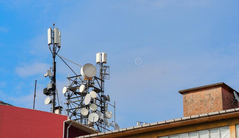 Base station on the roof in city center stock images