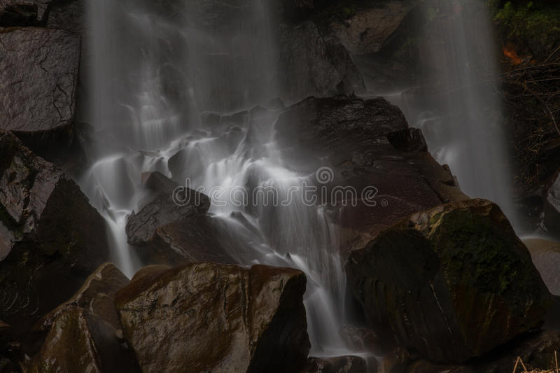 Base of waterfall, water cascading on rocks. royalty free stock photos