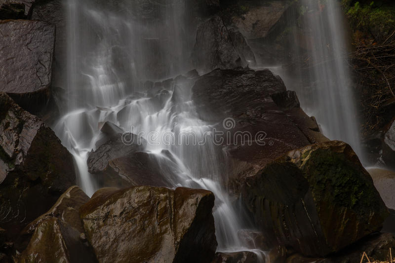 Base of waterfall, water cascading on rocks. stock image