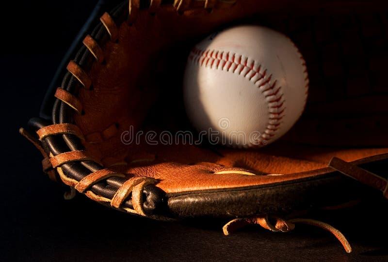 Baseball (2). Baseball glove and ball on black