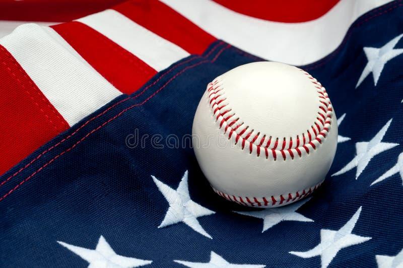 A baseball on the American flag. A white baseball on the American flag royalty free stock photos