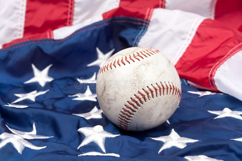 Baseball on American flag royalty free stock images
