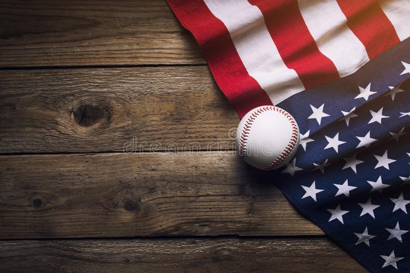Baseball with American flag in the background. Top view stock image