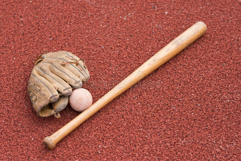 Baseball bat with ball and glove stock photography