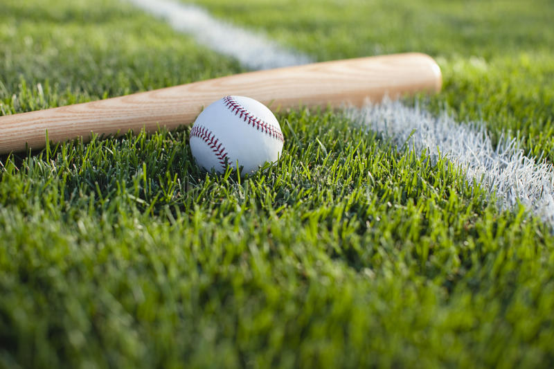 Download Baseball And Bat In Grass On A Stripe Stock Image - Image: 26439105