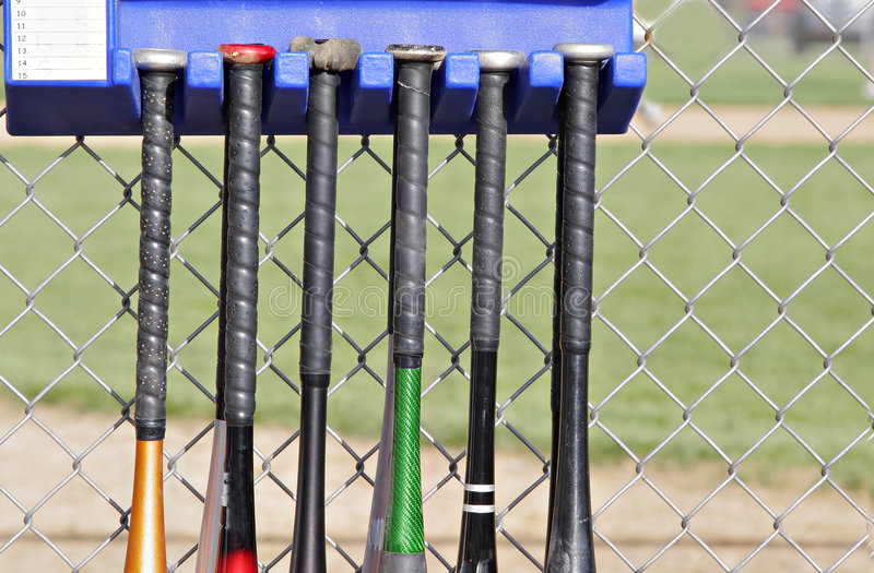 Baseball bats. Hanging outside the dugouts royalty free stock image