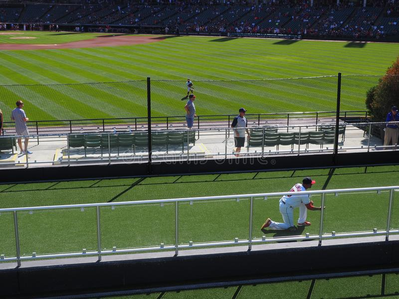 A catcher practicing defense in the bullpen in Cleveland at Progressive Field for the Indians. In baseball, the bullpen or simply the pen is the area where stock image