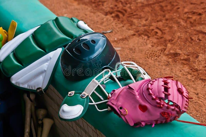 Baseball catcher equipments. The Arranged Multiple Baseball catcher equipments at Baseball field royalty free stock photo