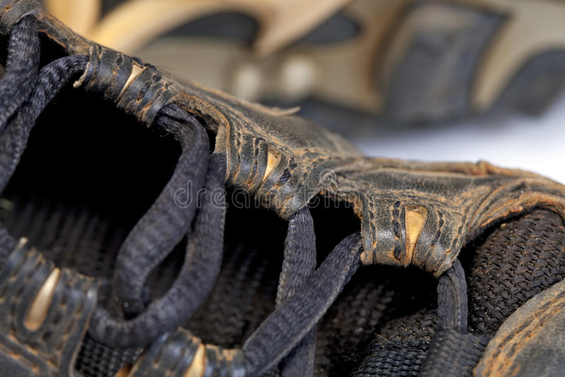 Baseball Cleats. Used baseball cleats against a white background royalty free stock photography