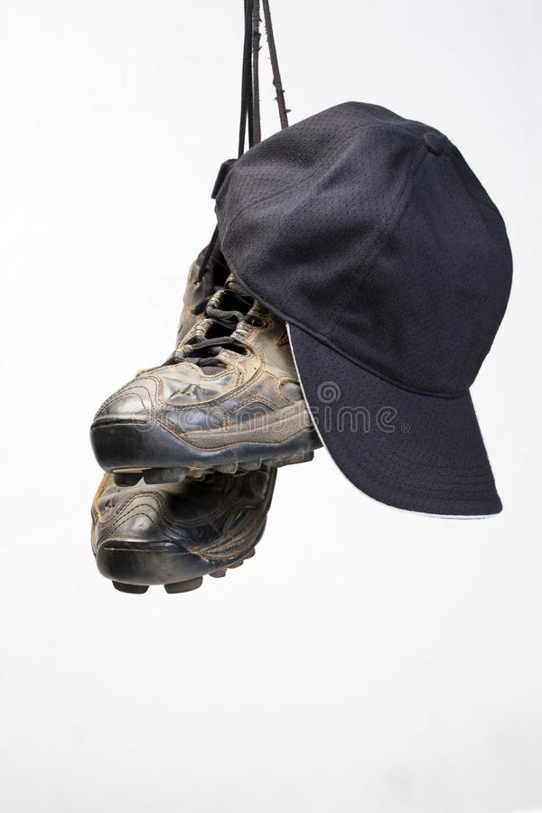 Baseball Cleats. Used baseball cleats against a white background royalty free stock photos