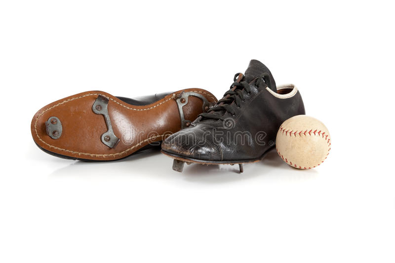 Baseball cleats on a white. A pair of baseball cleats on a white background stock photography