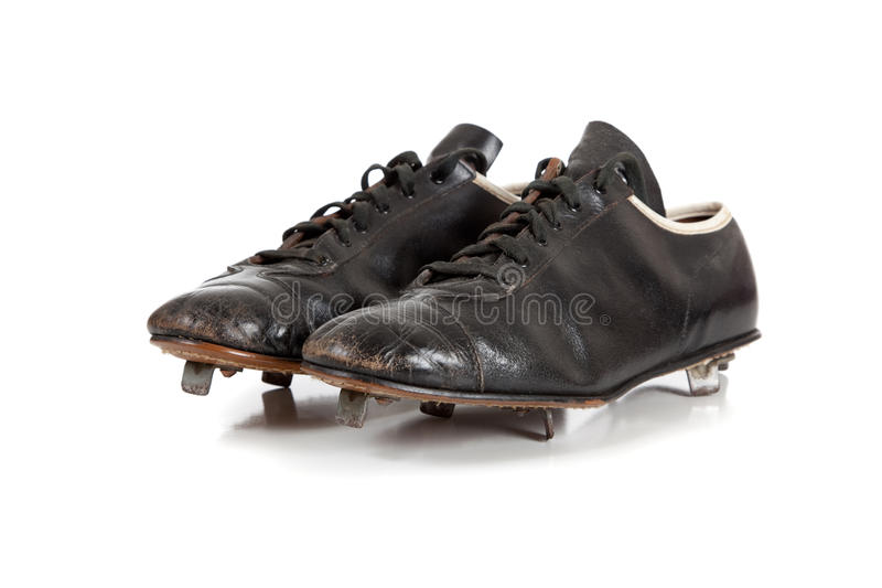 Baseball cleats on a white. A pair of baseball cleats on a white background stock image